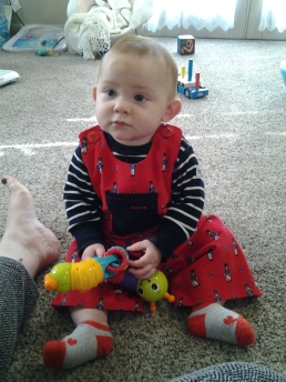 The little guy sporting the dungarees and a handsome bruise. He just started crawling...